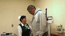 A nurse at Clinic No. 27 in Tijuana weighs Armando Huerta, a diabetes patient...