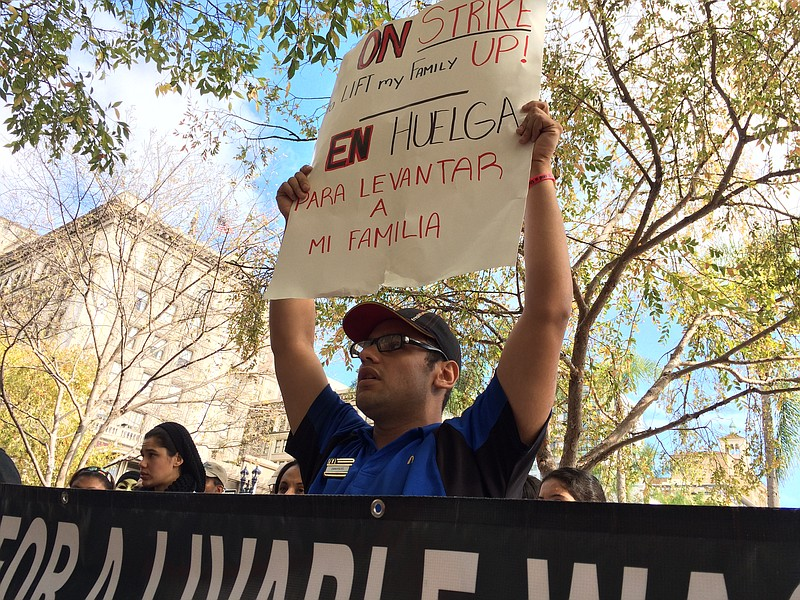 Emmanuel Wimers, a City Heights McDonald's worker, at a rally to push for hig...