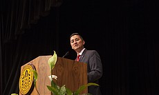 Chris Cate gives a speech after being sworn in ...