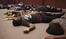 """Protesters staged a """"die-in"""" Wednesday during t..."""