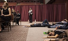 Protesters lie on the ground protesting police ...