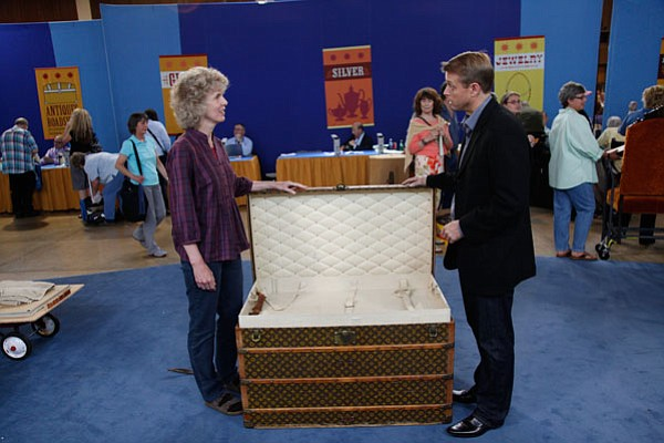 Brian Witherell (right) appraises a Louis Vuitton steamer...