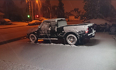 A truck is shown covered in snow in Murrieta on Dec. 31, 2014.  (49503)