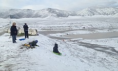 Children are shown sledding in Murrieta where snow covered parts of... (49494)