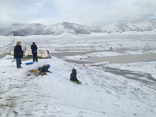 Children are shown sledding in Murrieta where snow covered parts of the city ...