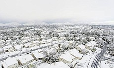 Snow is shown covering Temecula homes on Dec. 31, 2014.  (49497)