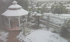 Snow is shown covering a Temecula neighborhood on Dec. 31, 2014.  (49513)