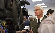 Sheriff Bill Gore is shown talking to the media...