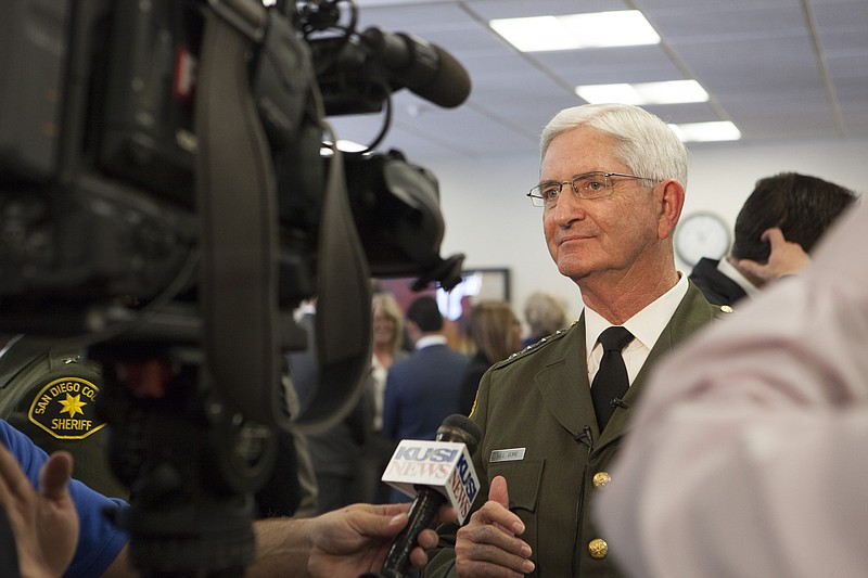 Sheriff Bill Gore is shown talking to the media after being sworn in for anot...