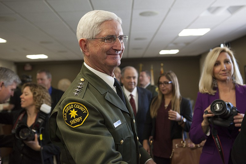 San Diego County Sheriff Bill Gore is shown talking with visitors at the Coun...