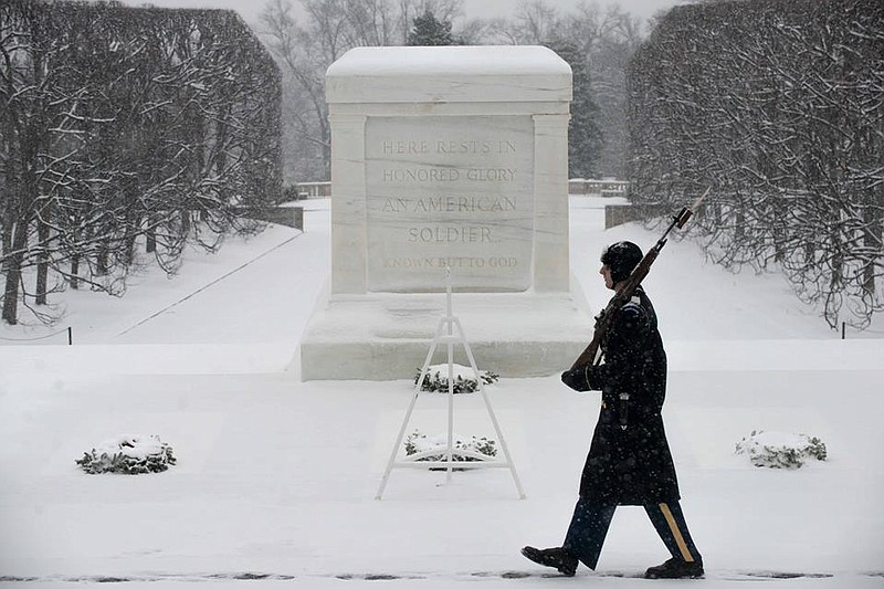soldier guards tomb of the unknowns during winter storm