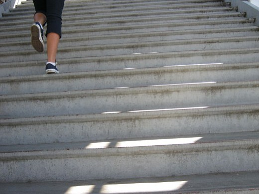 A student runs up stairs at Monroe Clark Middle School in City Heights.