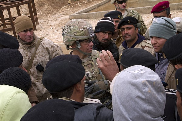 Command Sgt. Maj. Michael A. Grinston talks to Iraqi army...