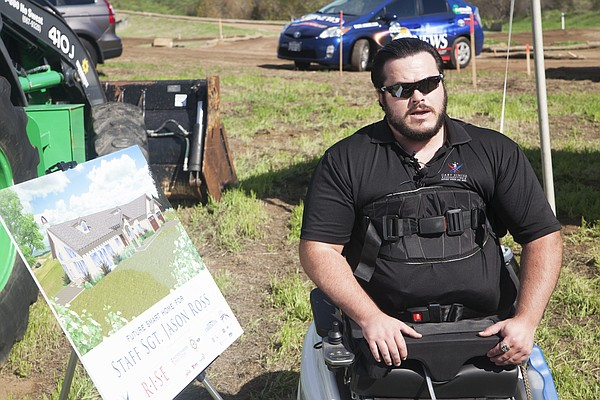Marine Staff Sgt. Jason Ross at the groundbreaking of his...