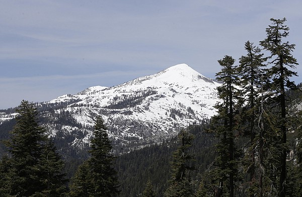 Snow covers the highest elevations of the Sierra Nevada n...