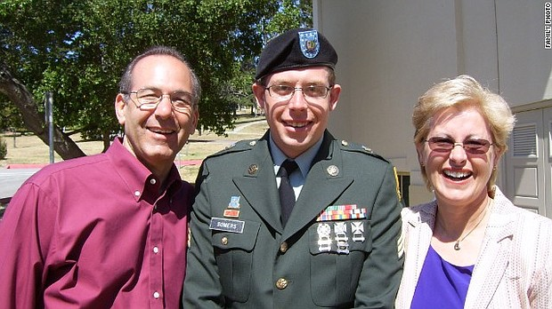 Dr. Howard Somers is pictured with his son Sgt. Daniel Somers and wife Jean in this undated photo. Daniel took his life in June 2013.