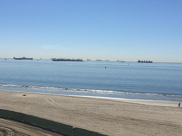 Cargo ships offshore in Long Beach wait to be unloaded as...
