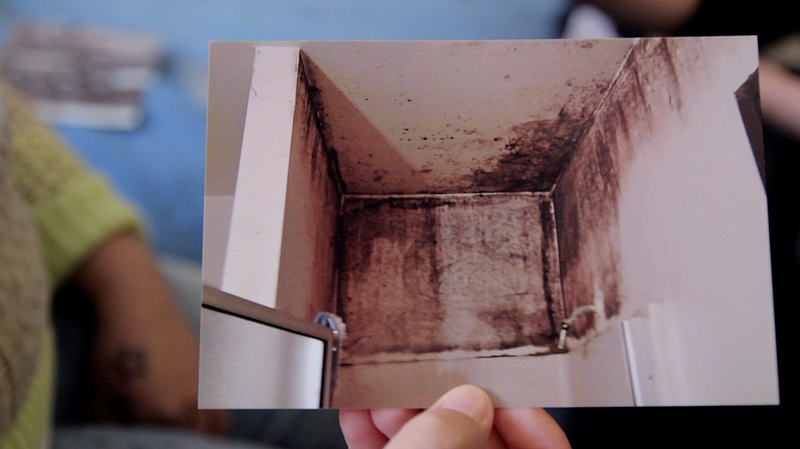 Karina Villanueva shows KPBS and Voice of San Diego a photo of mold above her...