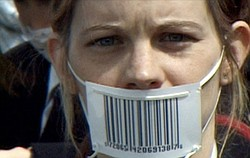 Film still of girl with barcode mask.