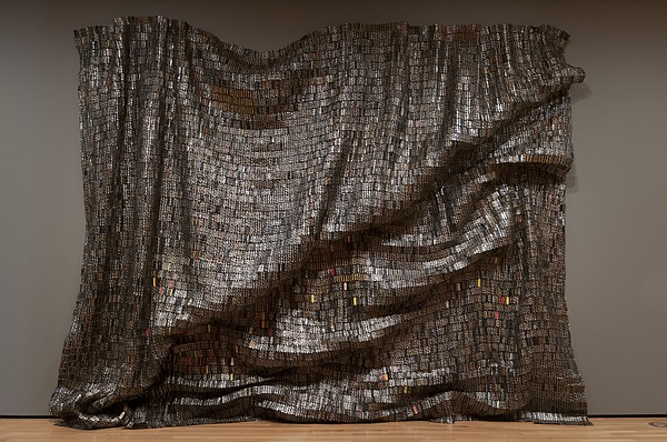 A hanging wall sculpture by African artist El Anatsui. It's called