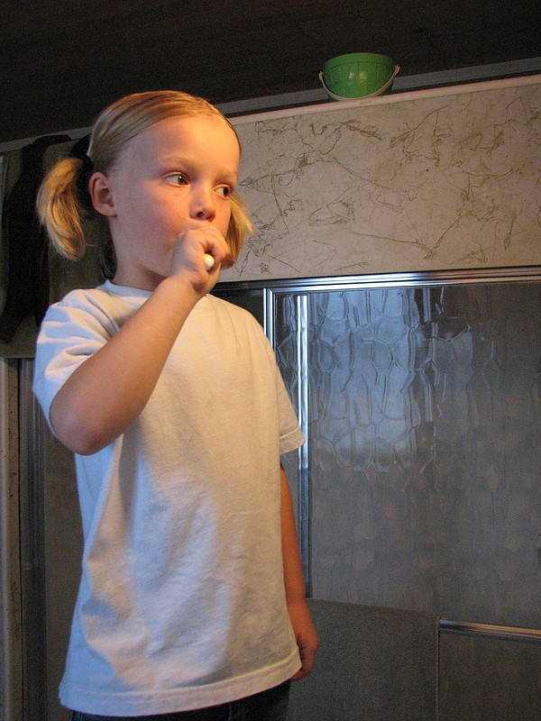 A young girl brushes her teeth, Oct. 2, 2009.
