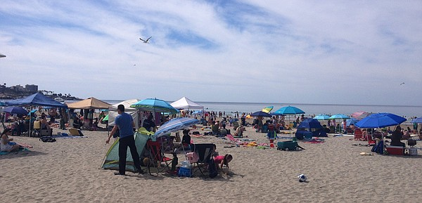 Hundreds of people fled to La Jolla shores for relief from hot temperatures, ...