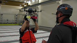 Wayne Perryman holds the hexacopter while John Durban handles the controller ...