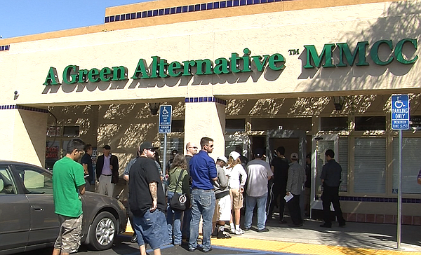 People line up in front of A Green Alternative in Otay Me...