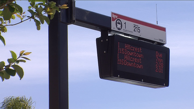 Bus wait times are displayed at a new Mid-City Rapid bus station April 6, 2015.