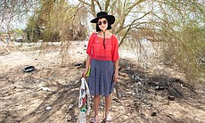 A portrait of Jesi the Elder, a young artist traveling through Slab City, March 28, 2015. She found a T-shirt in a trash pile and plans to wash it in the canal so she can wear it later.