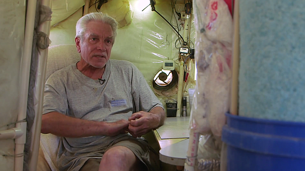 Slab City resident Gary Brown lives in an RV and is shown inside what he call...