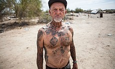 A Slab City resident poses for the camera, March 28, 2015.