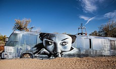 An artwork painted on a side of a bus by the East Jesus sculpture garden, March 28, 2015.