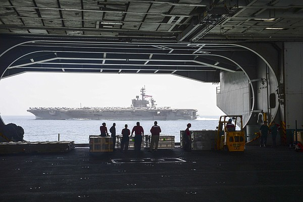 Sailors view the San Diego-based aircraft carrier USS Car...