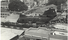 A military helicopter evacuates people from the...