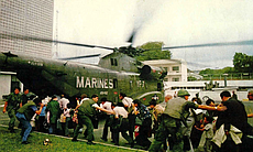 A helicopter is used to evacuate people from th...