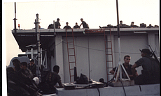 Marine Security Guards on the roof of the U.S. ...