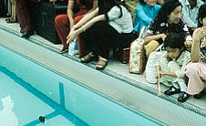 Evacuees lined up around the pool inside the U....