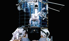 Astronauts replace the Hubble Space Telescope's...