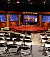 Studio set with stage and chairs for audience