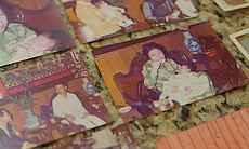 Photos show the Nguyen's Lunar New Year celebration in February 1975. Two months later, they would flee Saigon on a Navy ship. In the center photo, newborn Quan is pictured with his grandmother.