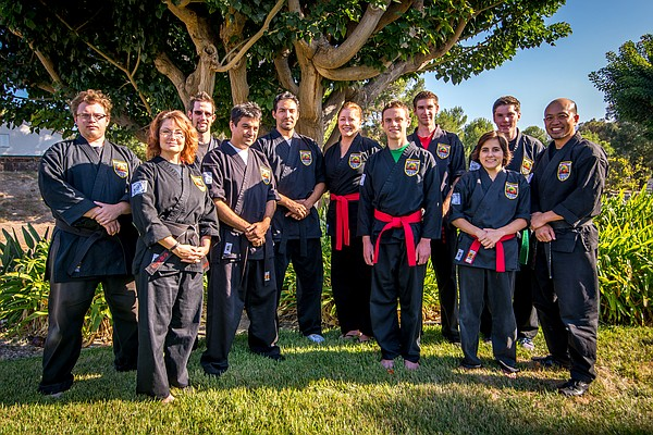Hoang pictured with martial arts instructors from the USS...