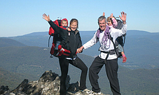 Dario and Sabin Schworer with two of their children are pictured hiking a mountain peak in this undated photo.