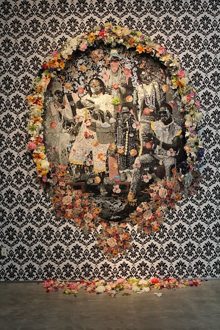 A mixed media wall tapestry by Ebony Patterson on view at...