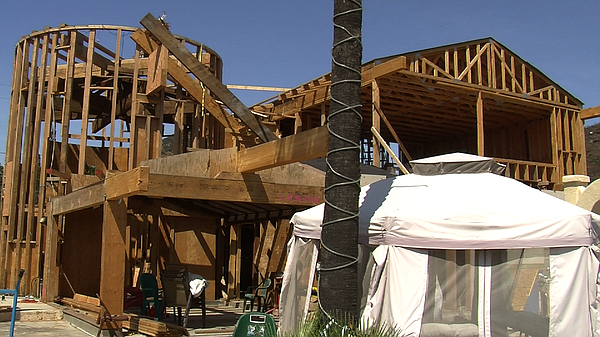 Wooden beams and plywood outline Dan Eubank's new home, w...