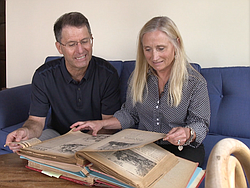 Former Ecke YMCA board members Bob Ayers and Lizbeth Ecke look at childhood photographs, April 23, 2015.