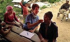 Scripps Health nurse Debra McQuillen is pictured working with a patient in Nepal in this undated photo.