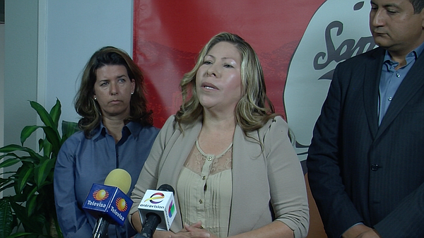 Maria Puga speaks at a press conference, April 14, 2015.