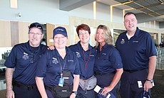 Pictured from left to right are Scripps Health employees Tim Collins (corporate vice president, operations and research), Patty Skoglund, RN (senior director of disaster/emergency), Debra McQuillen, RN (assistant vice president, cardiovascular services), Jan Zachry, RN (vice president and chief nursing executive) and Steve Miller, RN (senior director, clinical services) at the San Diego Airport in this undated photo.