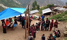 Nepal earthquake victims are pictured around Scripps Health nurse Jan Zachry in this undated photo.